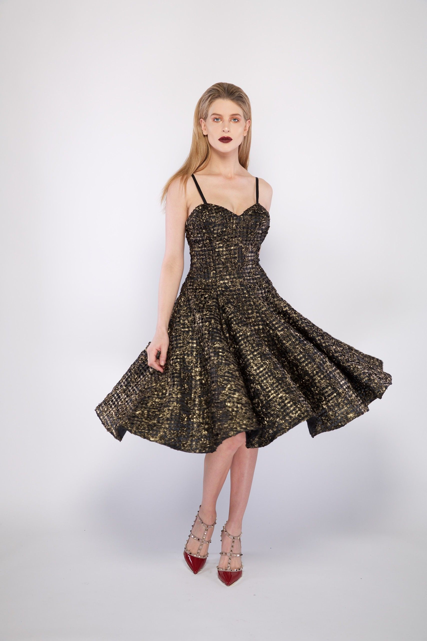 Gisele is a cocktail swing dress with a full circle skirt gold lace