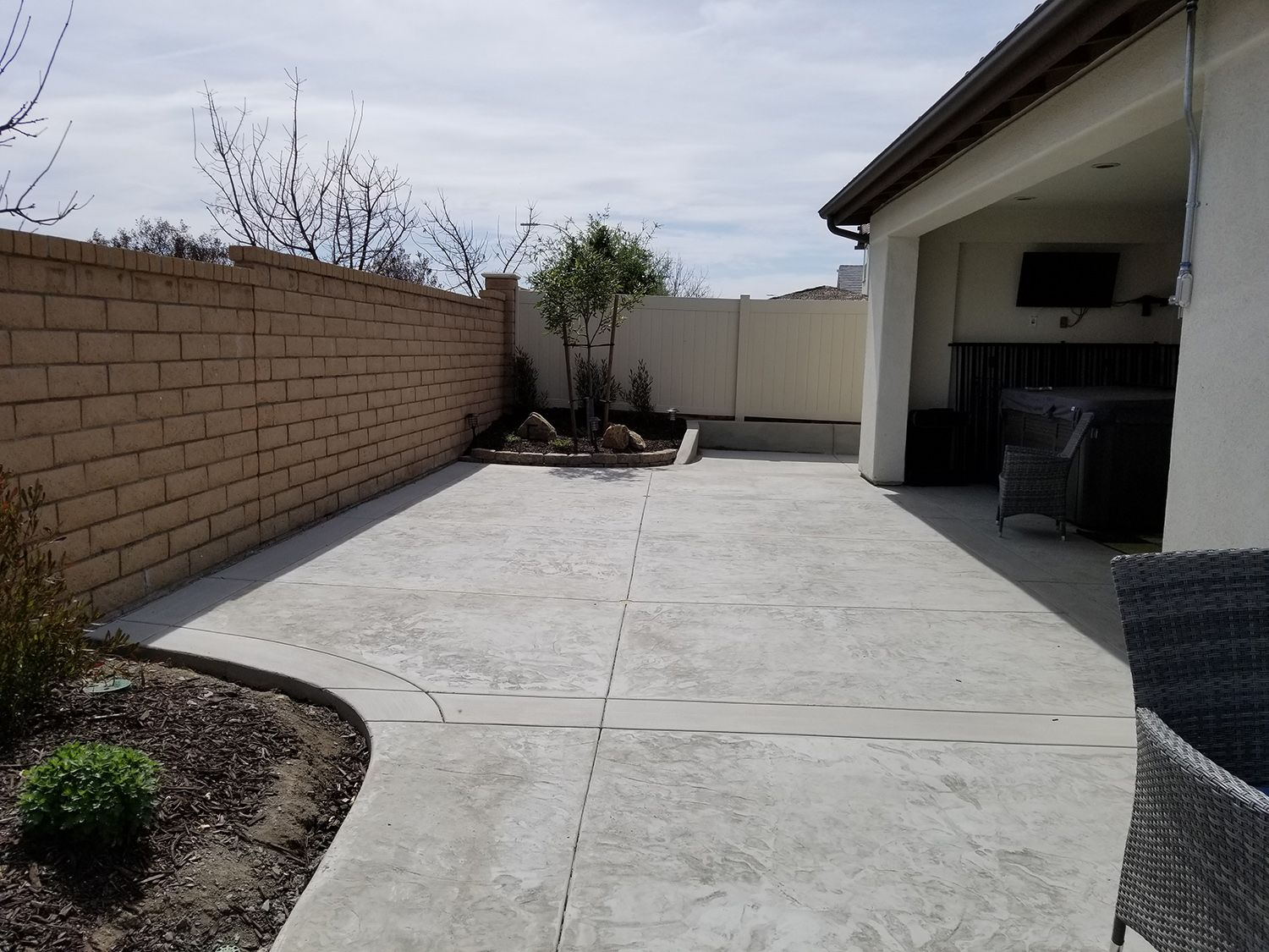 Grey Stamped Concrete Patio Extension With Concrete Retaining Wall Concrete Mccabes Stamped Concrete Patio Concrete Patio Concrete Retaining Walls