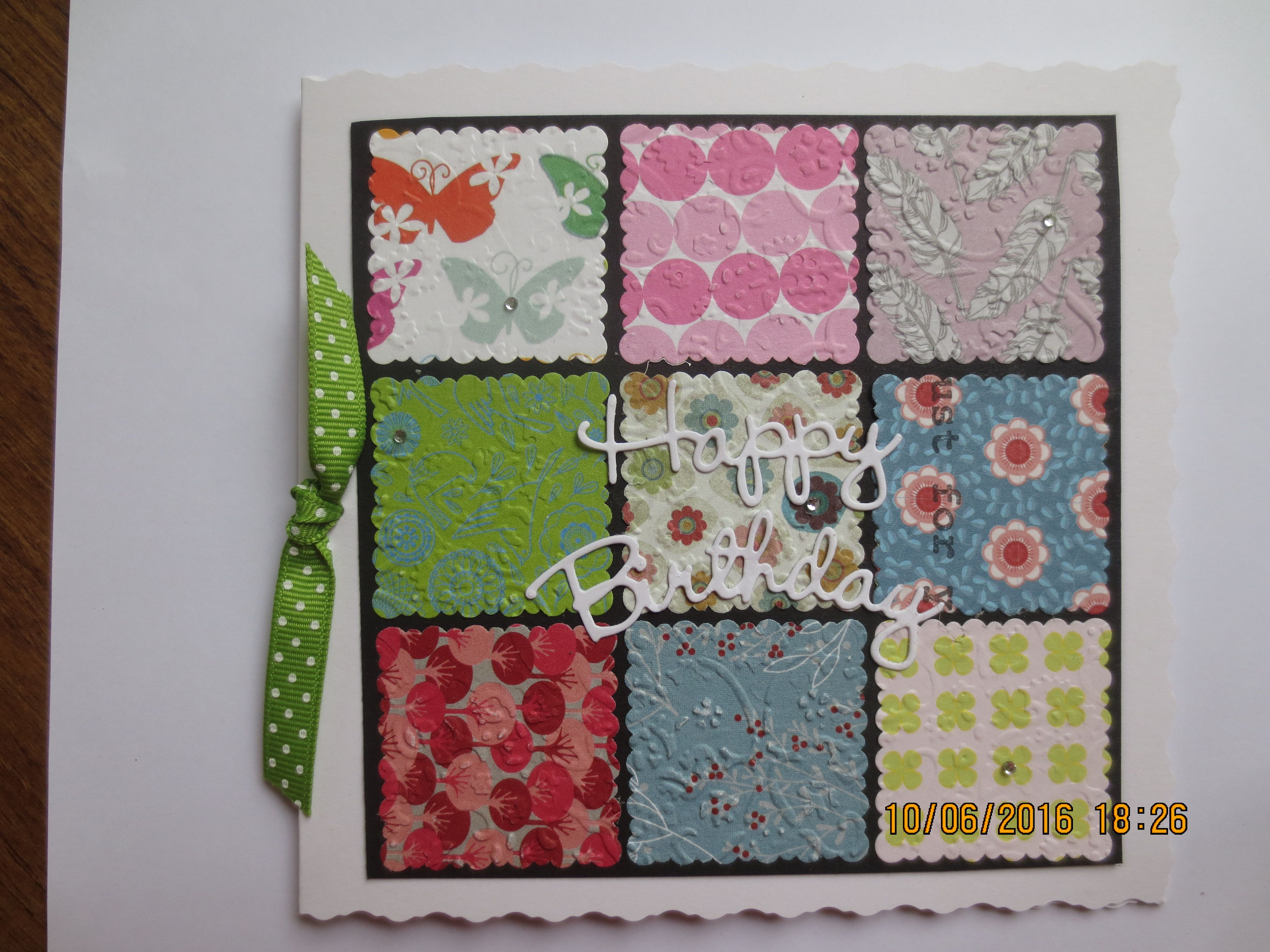 Multi colour patchwork using scraps of paper.