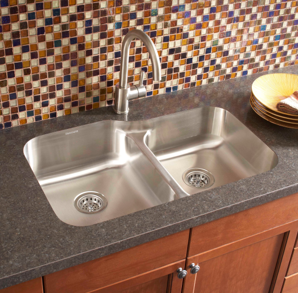 An undermount sink installed in a formica laminate countertop ...
