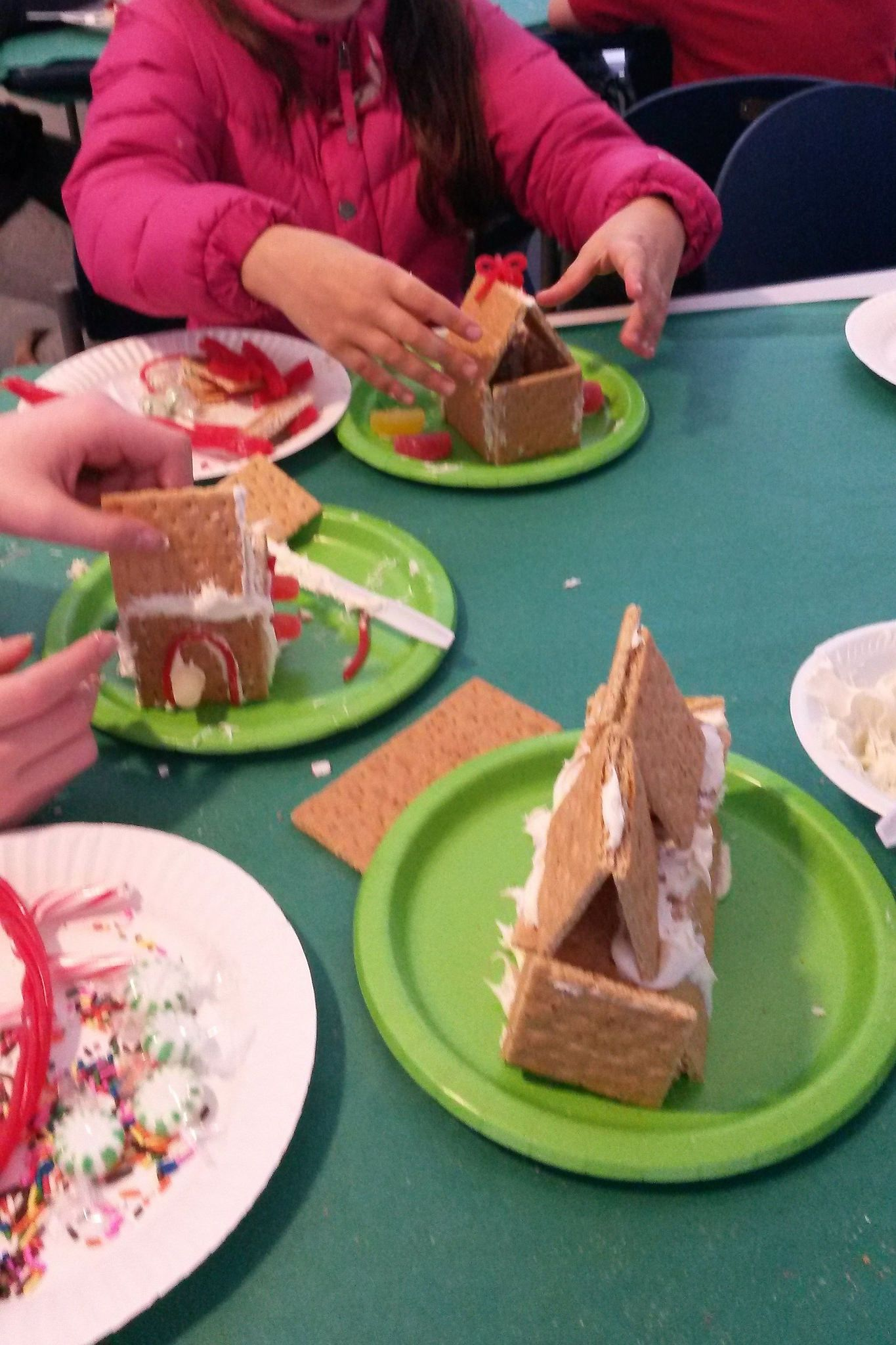 https://flic.kr/p/CunbQa | Tween Gingerbread Houses - Dec 19 2015 | Tweens got creative and made gingerbread houses out of graham crackers and other treats!  Dec. 19, 2015.