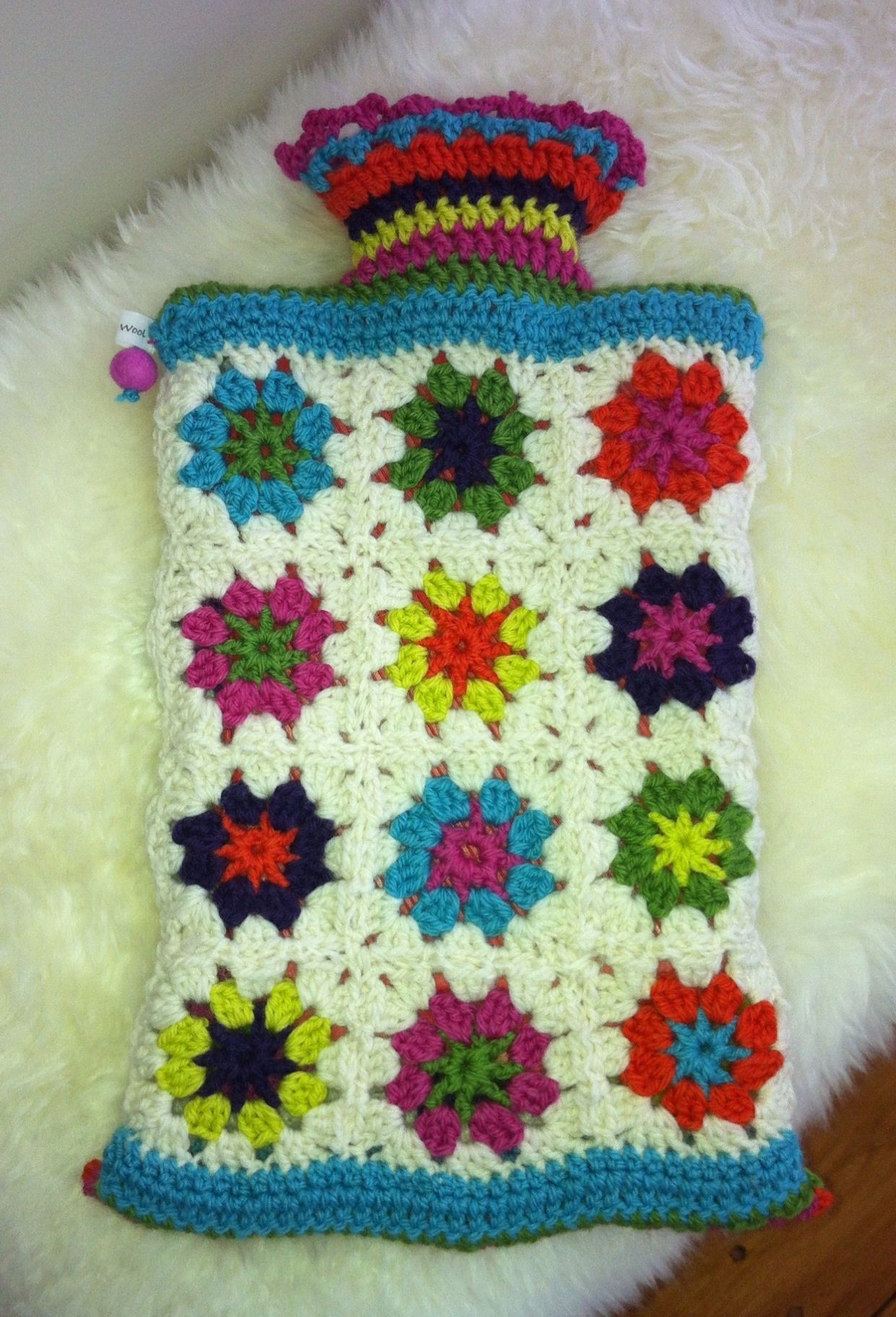 A oozy hot water bottle cover...made from various Attic 24 patterns ...