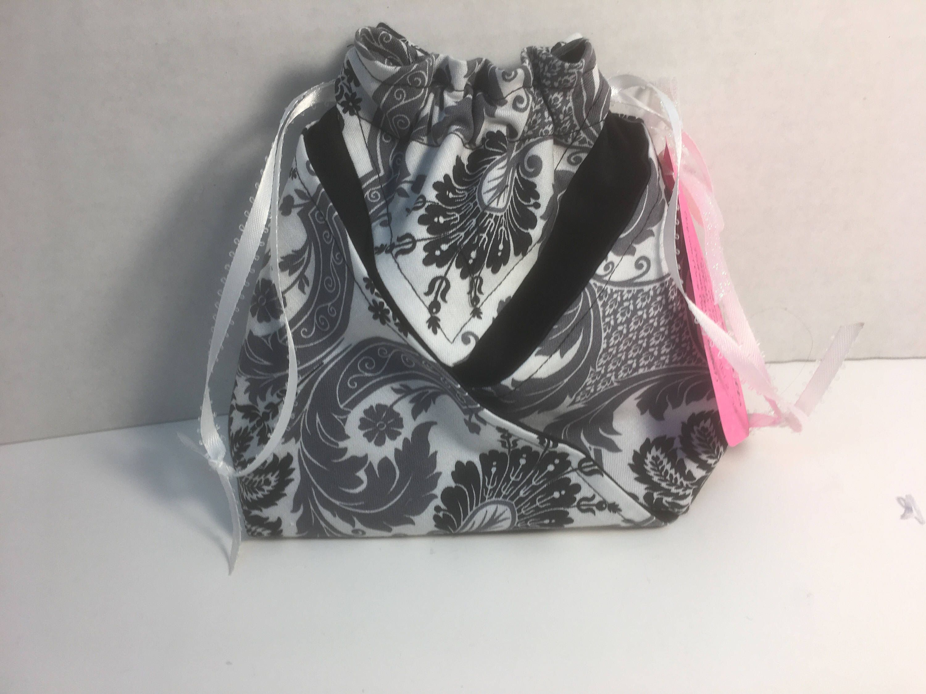 A personal favorite from my Etsy shop https://www.etsy.com/listing/517877696/gray-black-and-white-draw-string-bag