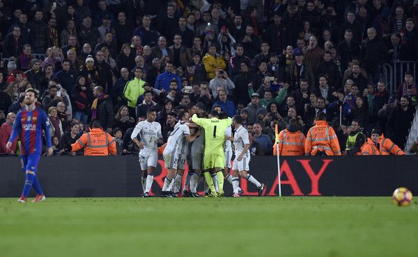 Real Madrid players celebrate a goal during the Spanish league football match FC Barcelona vs Real Madrid CF at the Camp Nou stadium in Barcelona on December 3, 2016. / AFP / LLUIS GENE