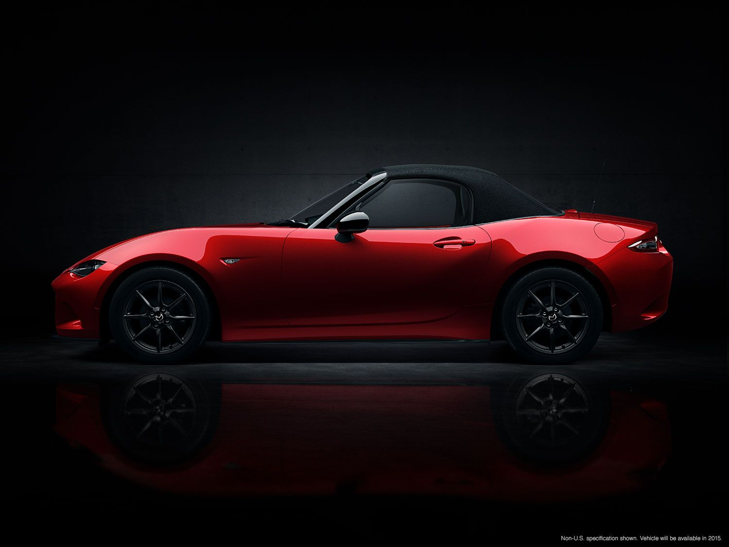 Side shot of the allnew 2016 MX5 with the top up
