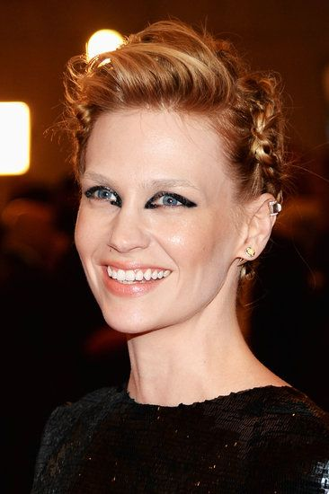 January Jones: January Jones paired a headful of braids with a sleek, brushed-back bang. Her eye makeup was a disjointed shape that focused on the inner and outer corners.