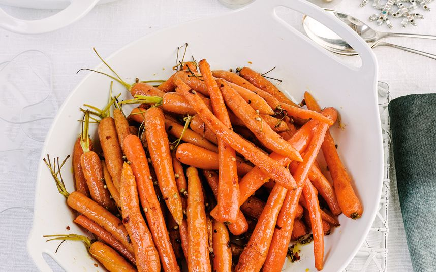 Roasting carrots with coriander, chilli flakes and grated orange zest is an   easy way to pep up winter veg