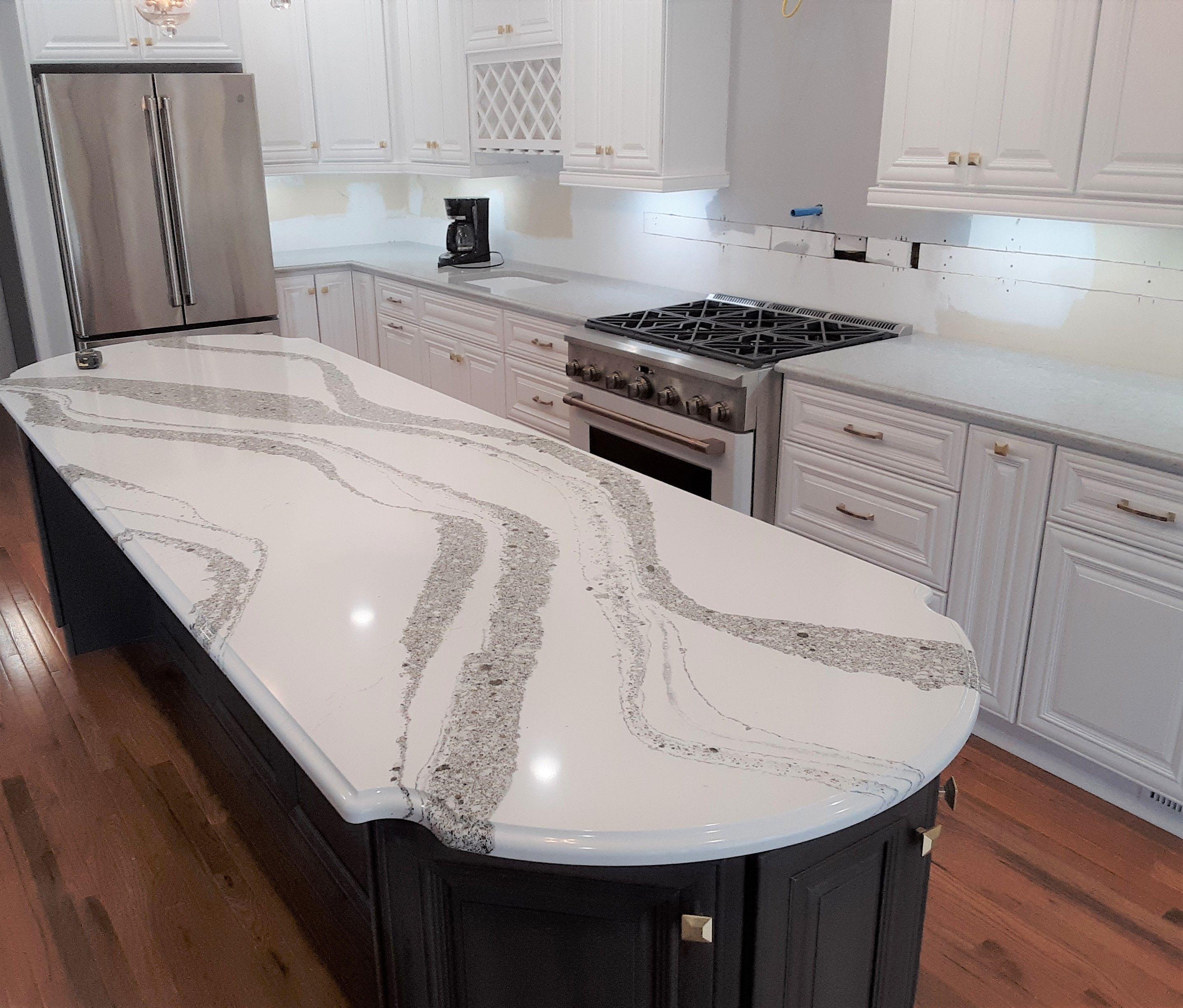 Annicca By Cambria Quartz With An Ogee Edge Profile Gorgeous Centerpiece Stone Interior Custom Countertops Quartz Countertops