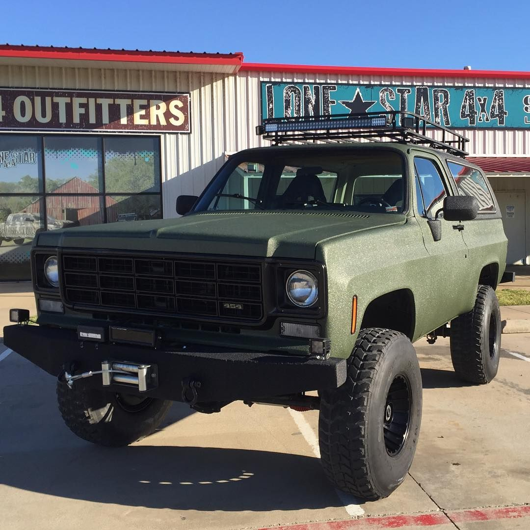 1978 blazer with custom bumpers rigid ir led lights and hyperspots custom roof rack racing fuel cell and custom sprayed in od green w black accents  [ 1080 x 1080 Pixel ]