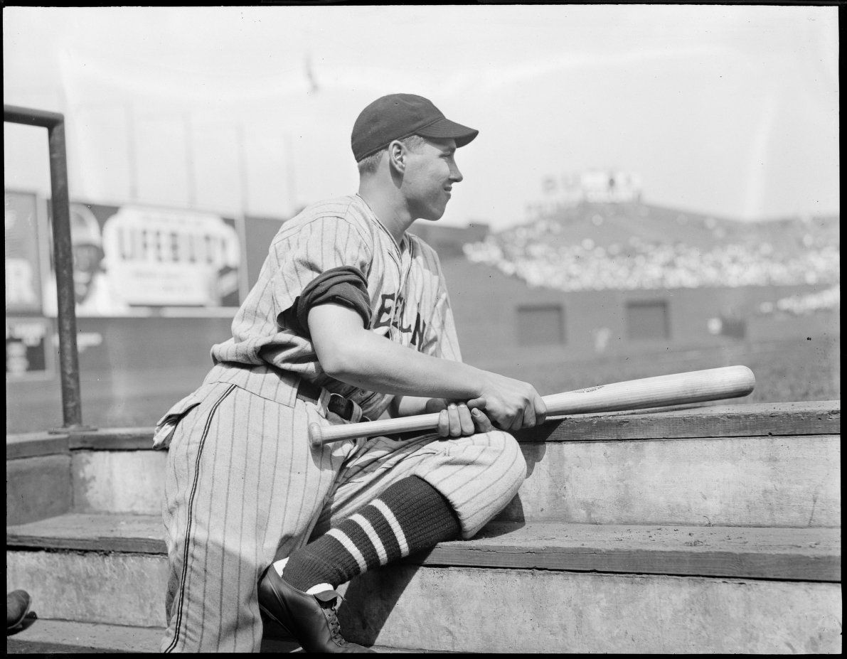 70968327b51 Cleveland Indian Bob Feller sitting on the dugout steps with a bat at  Fenway Park 1937.