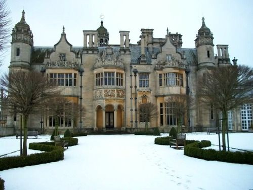 Side elevation, Harlaxton Manor in the snow, Harlaxton, Lincoln, England. The manor, built in 1837, combines elements of Jacobean and Elizabethan and helped to usher in the Elizabethan revival early in the Victorian era. Architect Anthony Slavin was responsible for the exterior, while architect William Burn was responsible for the interior detailing.
