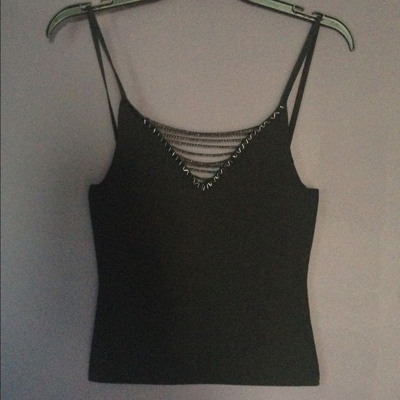 New! Beaded Black Tank Never worn--perfect condition--Small black tank top with beaded area over cleavage. (50% nylon/ 50% rayon) short body length (from top of straps to bottom-21 in/from top of main shirt area to bottom-15 1/2 inches) So cool Tops Tank Tops