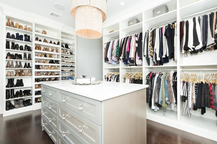 Large Master Closet Ideas Wall of custom shoe shelves in a large master closet organizes shoes and  accessories with an adjacent wall shelf displaying stacked racks of  clothing.