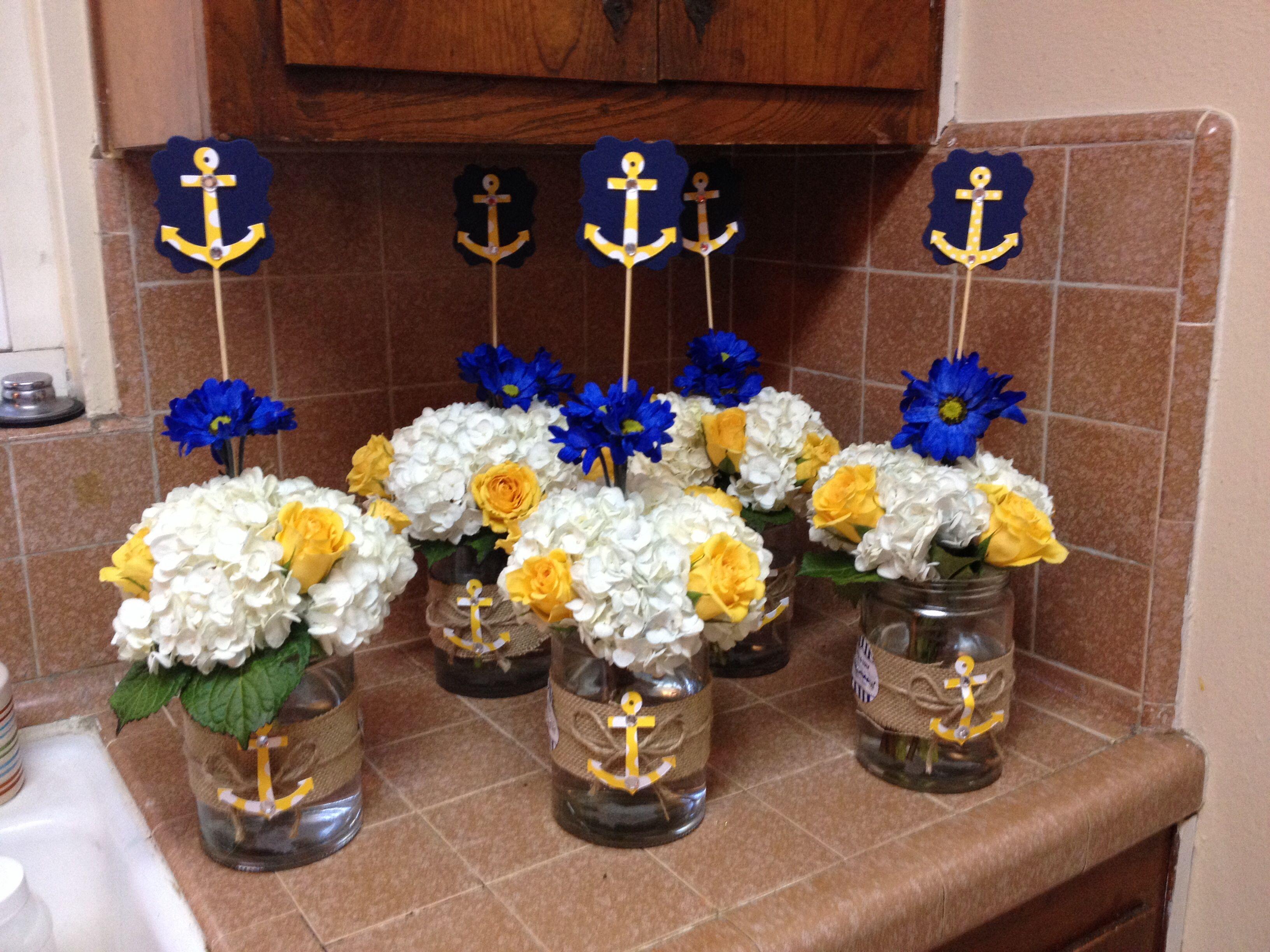 White yellow blue flower arrangement for a nautical theme baby white yellow blue flower arrangement for a nautical theme baby shower izmirmasajfo