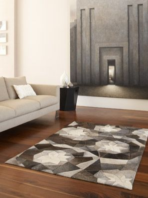 The perfect finish to any new floor is a beautiful rug.