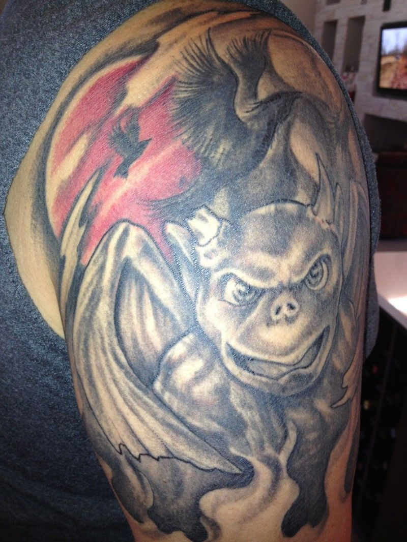Gargoyle with black raven tattoo on shoulder | Gargoyle ...
