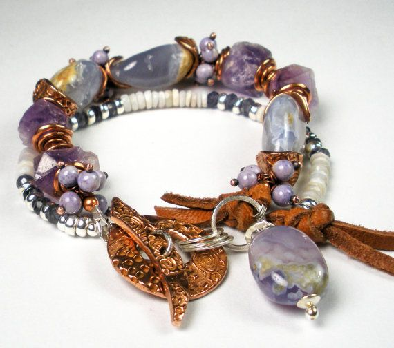 """""""Twilight Mist"""" –is a double-strand, gemstone beaded, mixed metal (primarily copper combined with sterling silver) bracelet. The first strand features natural, smooth, holly blue chalcedony nuggets...rustic/hammered natural amethyst nuggets… and sprays of copper wire wrapped, lavender river stone rounds. The second strand features skinny, faceted natural Australian opal rondelles...faceted iolite rondelles...and sterling silver spacers.  The metal work includes my handmade spiraled and h..."""