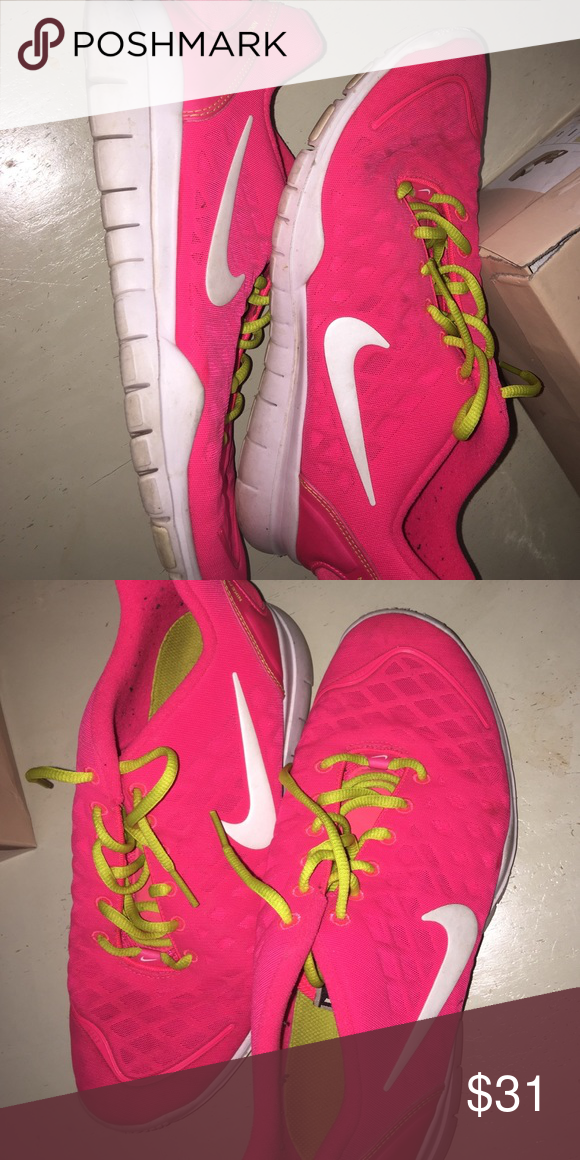 Neon pink and lime Nike tennis shoes Decent condition! Gently used Nike Shoes Sneakers