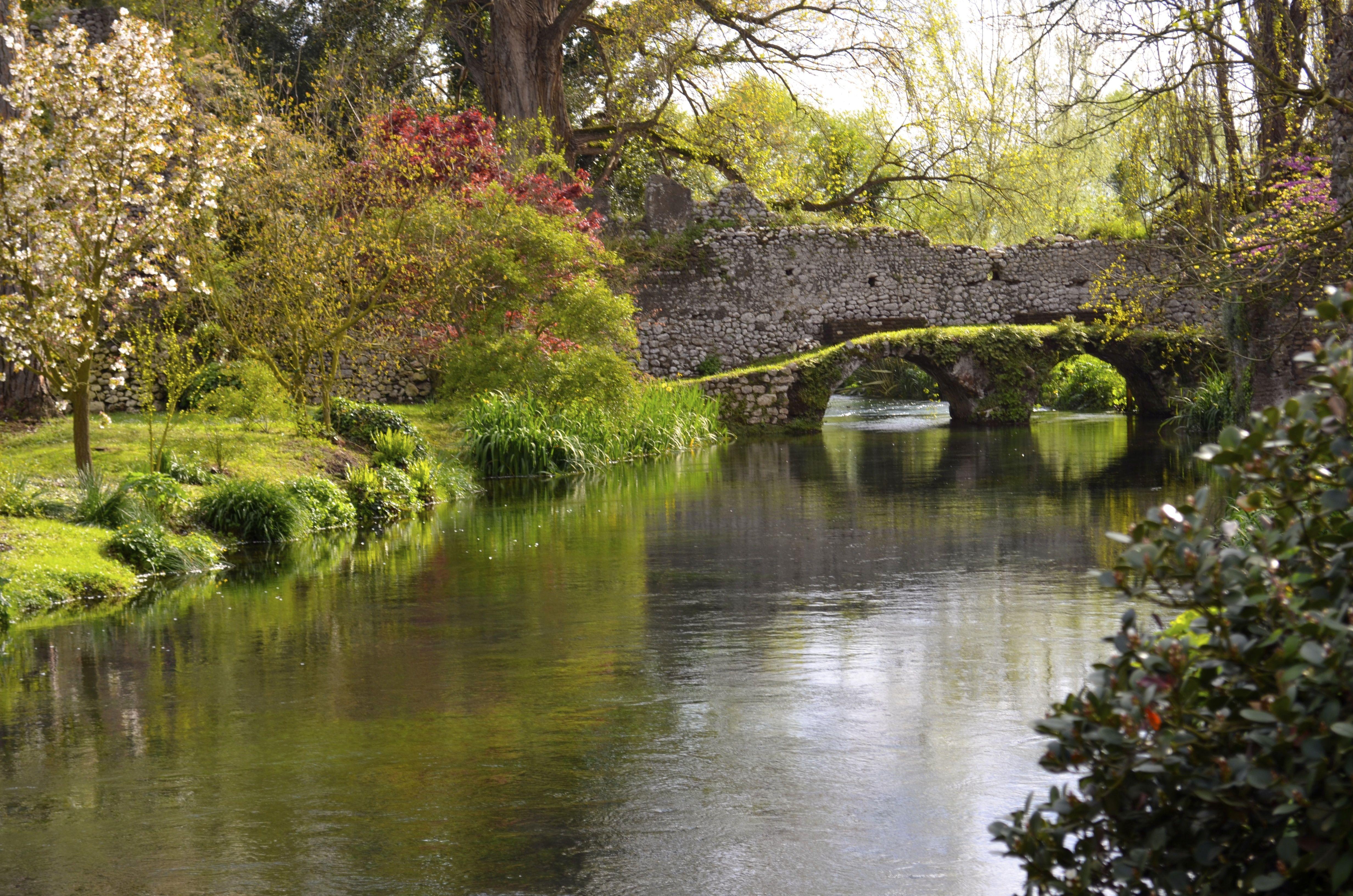Set in a ruined medieval town, the romantic Ninfa Gardens are located in the Lazio region of Italy, 40 miles southeast of Rome #Ninfa #Castello_Caetani #Sermoneta #Latina #Lazio #Italy