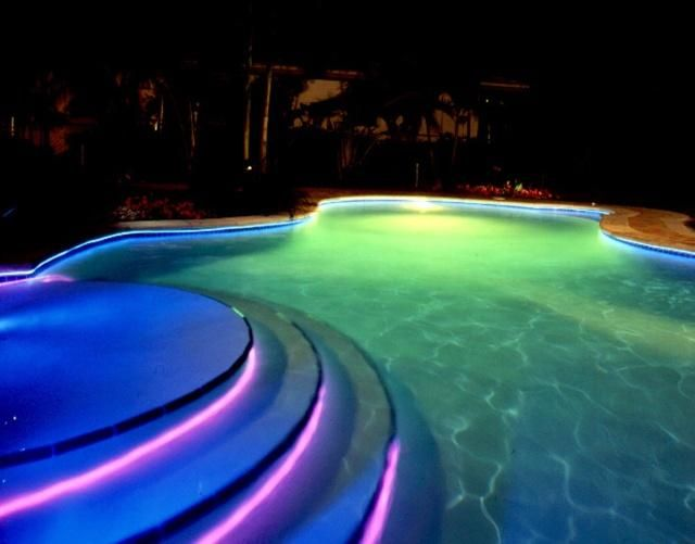 Unique residential swimming pools swimming pool lights for Above ground pool lighting ideas