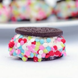 Add instant life to the party with these cute and colorful ice cream sandwich treats made from Oreo cookies.