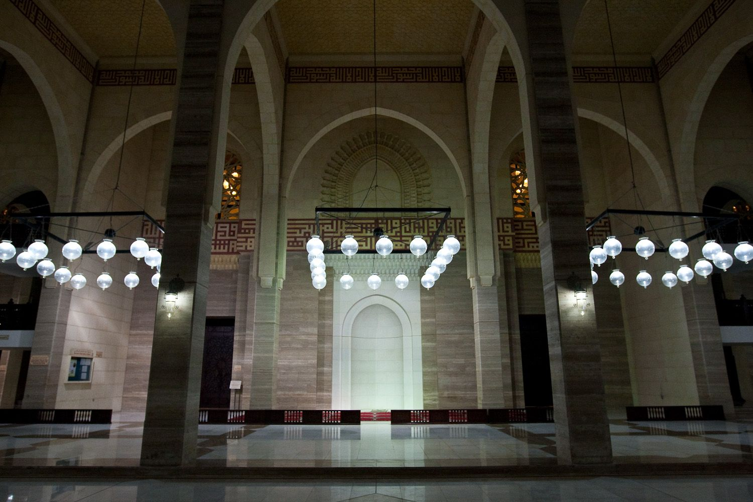 Bahrain - Al Fateh Grand Mosque - Interior - The doors are made of teak wood from India. Throughout the mosque are calligraphy writings in a very old type of style called Kufic.
