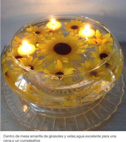 Fuente con girasoles agua velas y una bandeja de vidrio es - Centros de mesa con velas ...