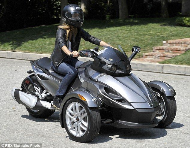 stacy keibler goes hell for leather on three wheeled motorbike wheels leather and the o 39 jays. Black Bedroom Furniture Sets. Home Design Ideas