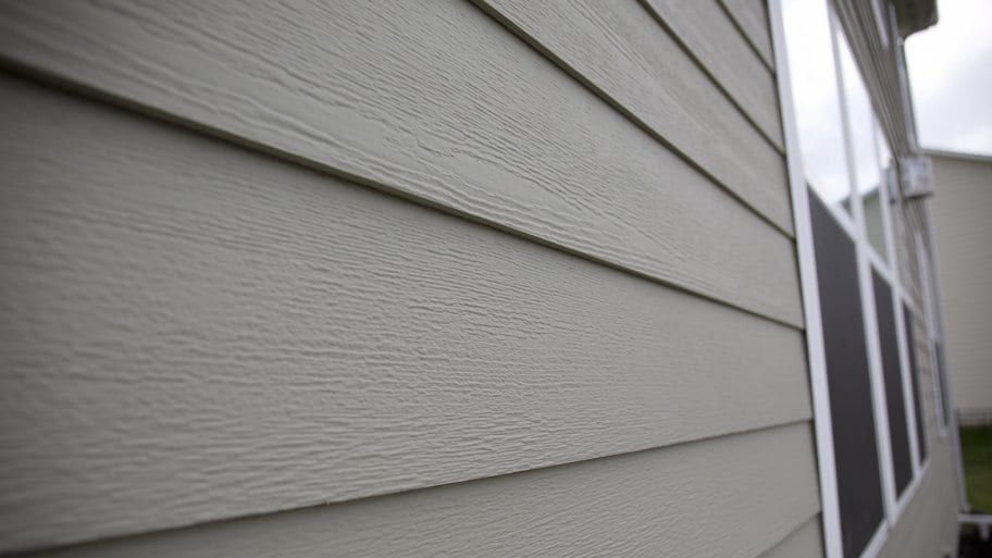 Fiber Cement Siding On Home Fiber Cement Siding Cement Siding Concrete Siding
