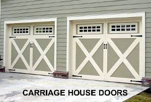 Carriage House Garage Doors WIth Huge Rustic Lantern Style Lighting On  Either Side