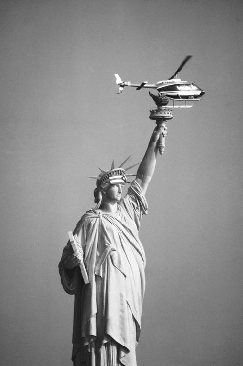 A helicopter hovers over the Statue of Liberty in New York harbor on Tuesday, Oct. 25, 1977 after about two Dozen Demonstrators occupied the Statue and draped its forehead with a Puerto Rican flag. The group, who were calling for Puerto Rican independence and for release of four Puerto Rican nationalists serving terms for the 1954 shooting of five congressmen, held the Statue for nine hours before being rounded up. (AP Photo/JR). S)
