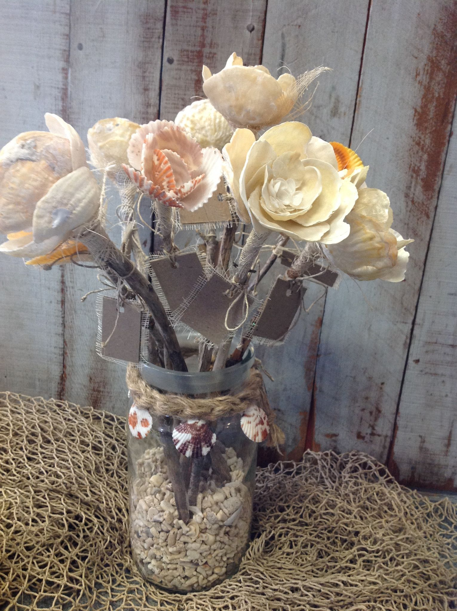 Seashell flowers sea shells pinterest natural flower and shell straight from a mermaids garden these beautiful handmade flowers are made from natural seashells all colors are natural if there is a specific flower izmirmasajfo