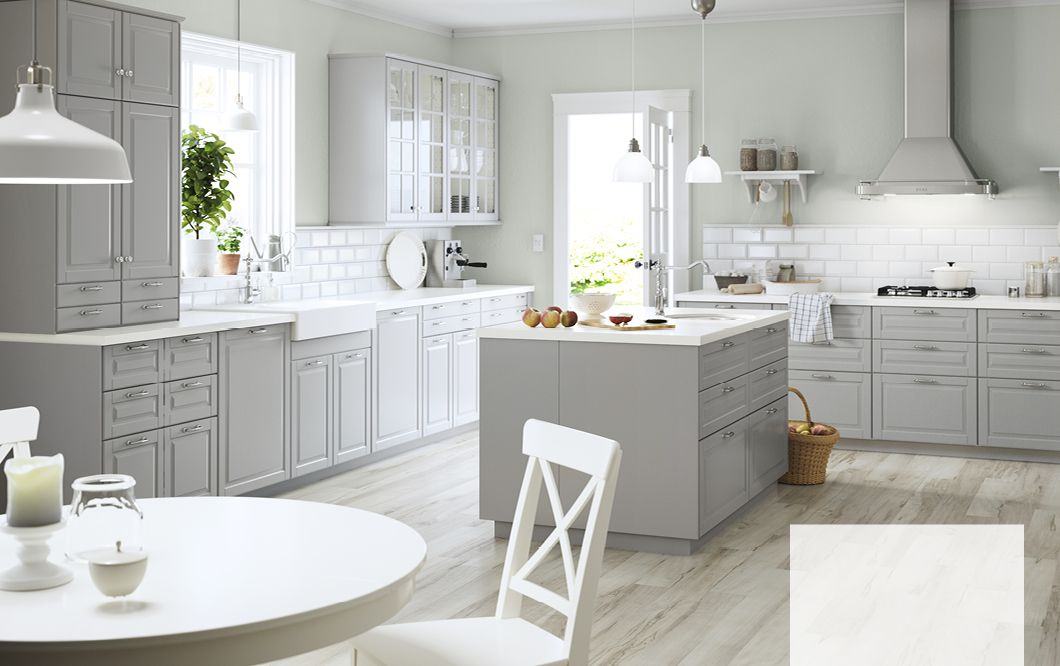 A Large Grey Country Kitchen With A Lot Of Drawers, Wall