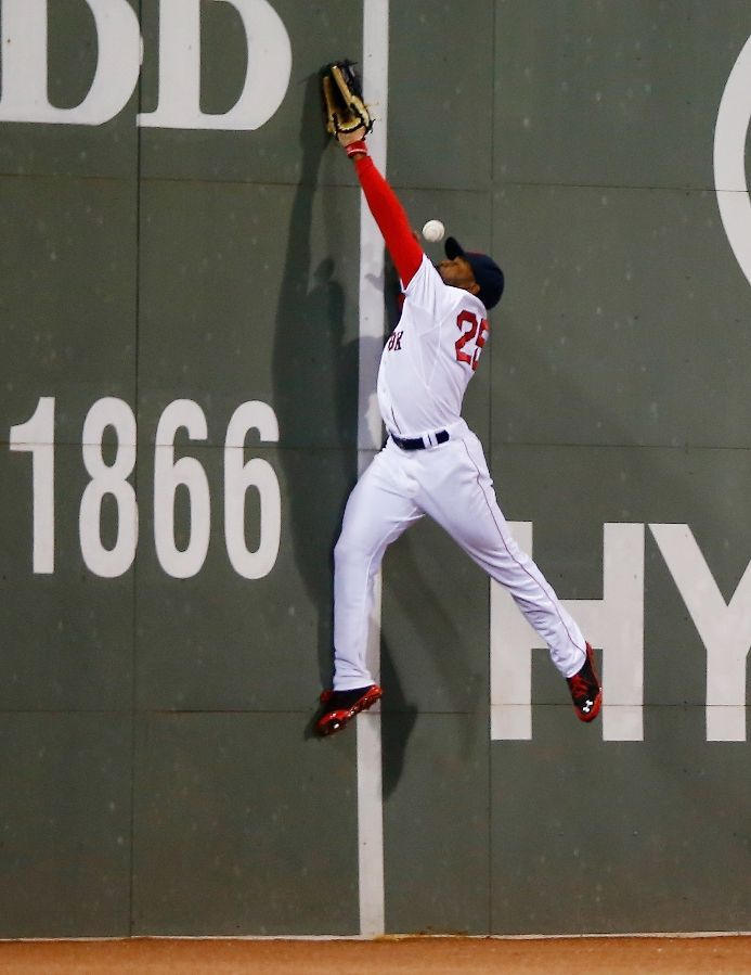 BOSTON, MA - MAY 31: Jackie Bradley Jr. #25 of the Boston Red Sox leaps for a fly ball in center field before missing the catch and allowing a run to score in the 8th inning against the Tampa Bay Rays during the game at Fenway Park on May 31, 2014 in Boston, Massachusetts. (Photo by Jared Wickerham/Getty Images) ** They failed to mention the ball hit him in face causing a nosebleed, and he stuck it out the rest of the game!**