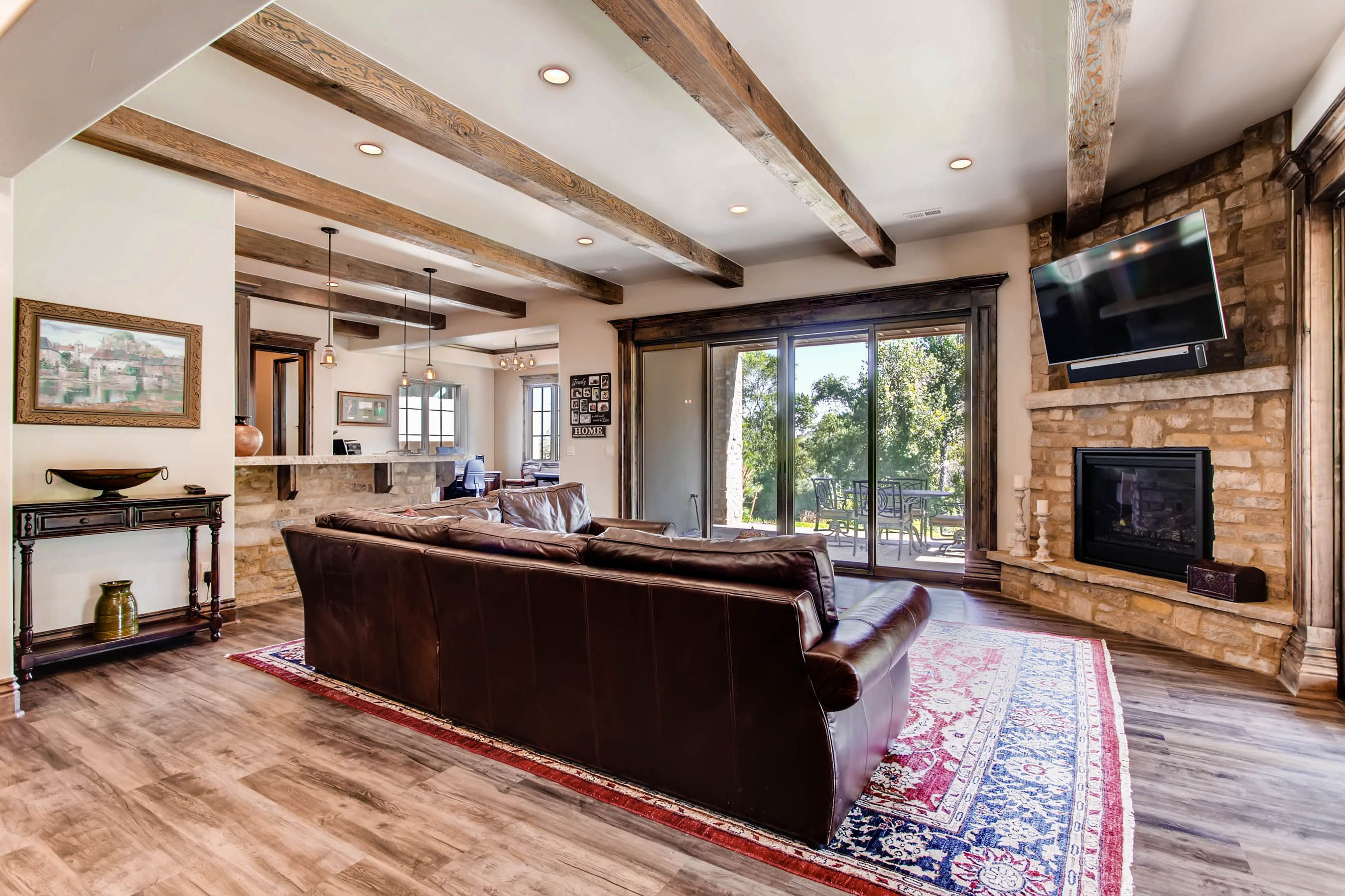 Large Finished Bat That Opens Out Onto A Cover Patio Rustic Open Floor Plan With Corner