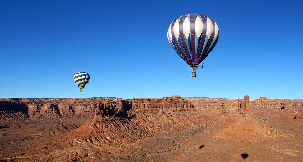 Hot air balloons soar above red rocks of southern Utah. (Brett Prettyman  |  The Salt Lake Tribune)