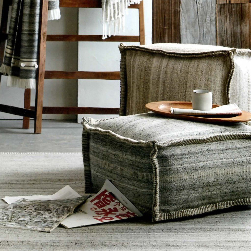 Wintery white and warm gray tones transport us to scandinavia our oslo poufs are woven from heathered wool and viscose yarn with natural tonal striations
