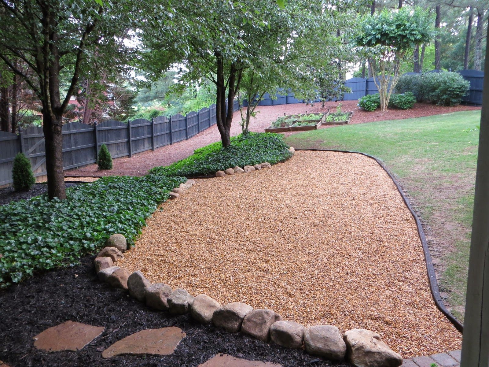 Pea gravel and stone seating new pea gravel patio area Backyard designs with gravel