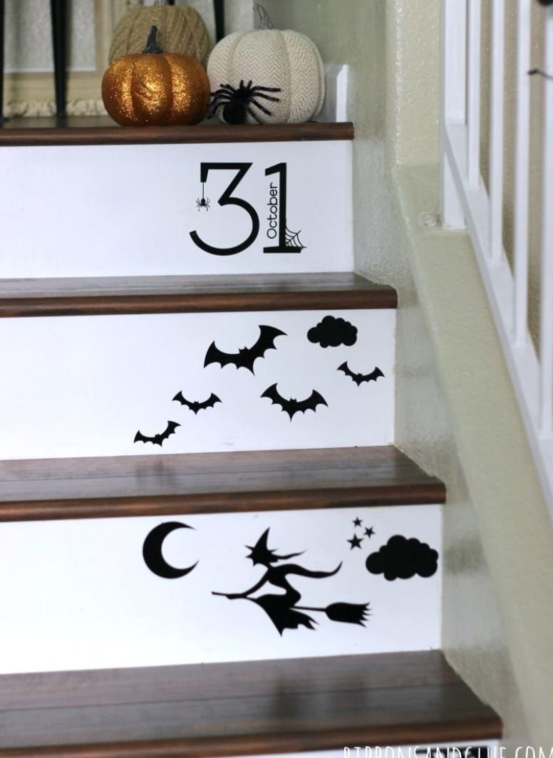 Halloween Vinyl Staircase made with Silhouette CAMEO. Halloween cut files cut out in black vinyl adhered up a wooden staircase for Halloween #halloween #halloweencostume #halloweendecor