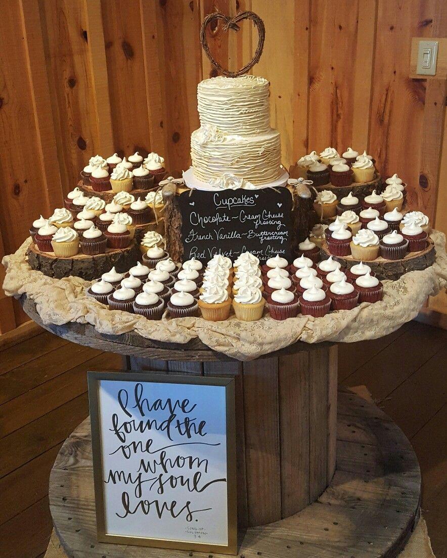 Rustic ruffled cake & cupcakes Wedding cake display