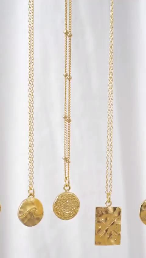 Photo of Golden Sun Necklace Collection