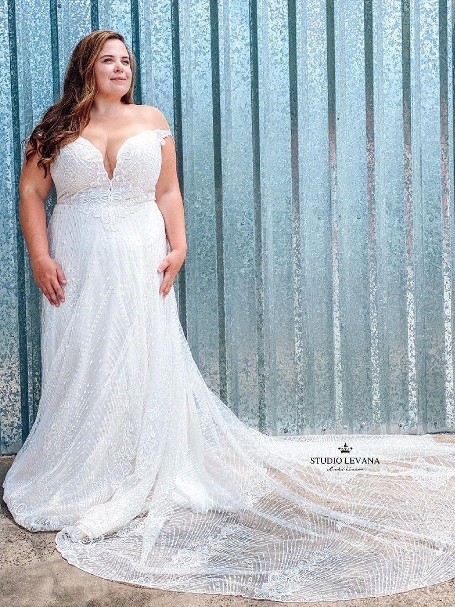 Nathale Off Shoulder Plus Size Wedding Dress By Studio Levana Wedding Dresses Plus Size Bridal Dresses Dresses [ 1182 x 887 Pixel ]