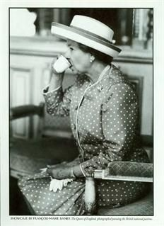 Queen Elizabeth drinking tea