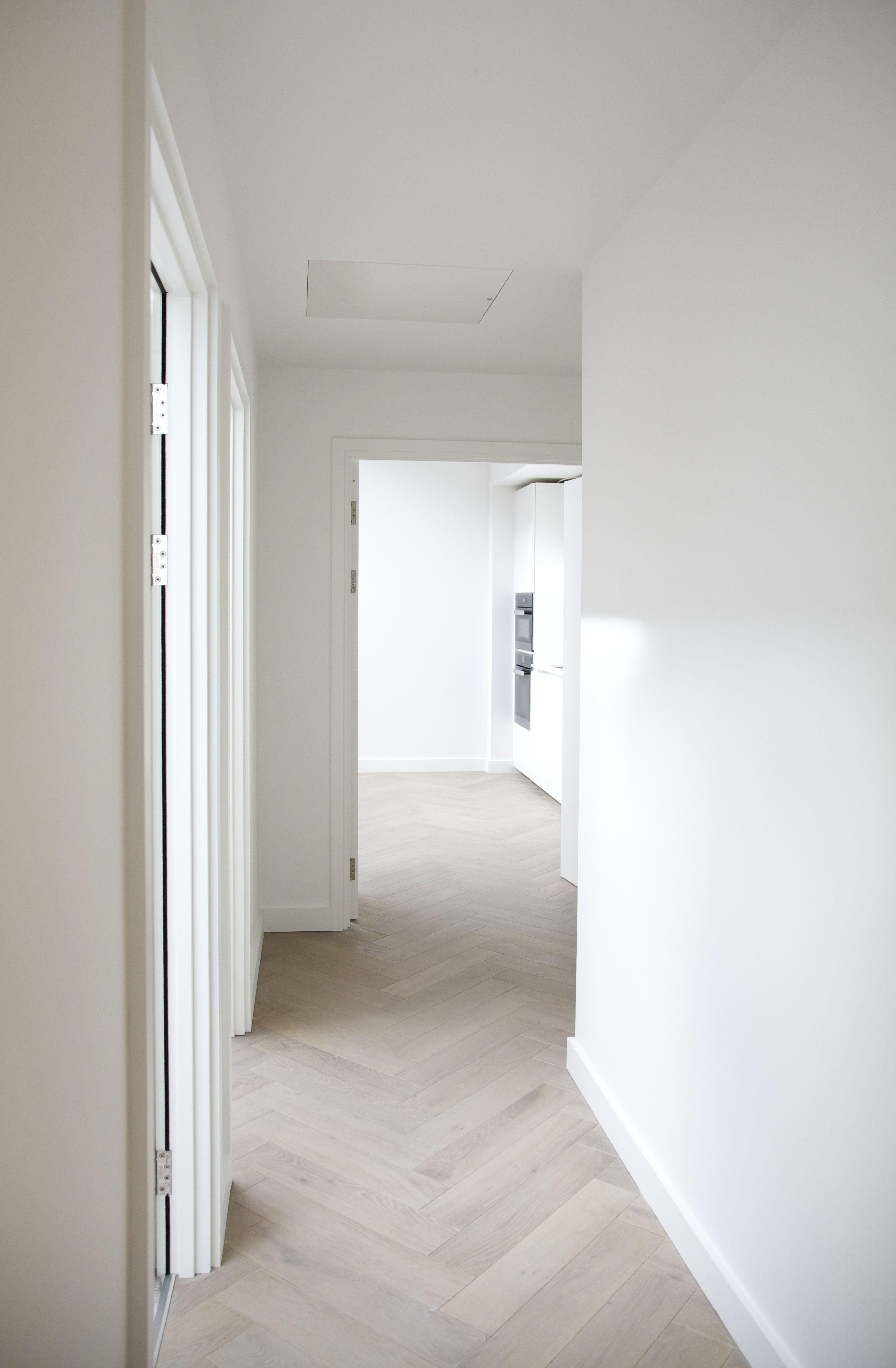 white linen walls pale lime wash fishbone flooring living