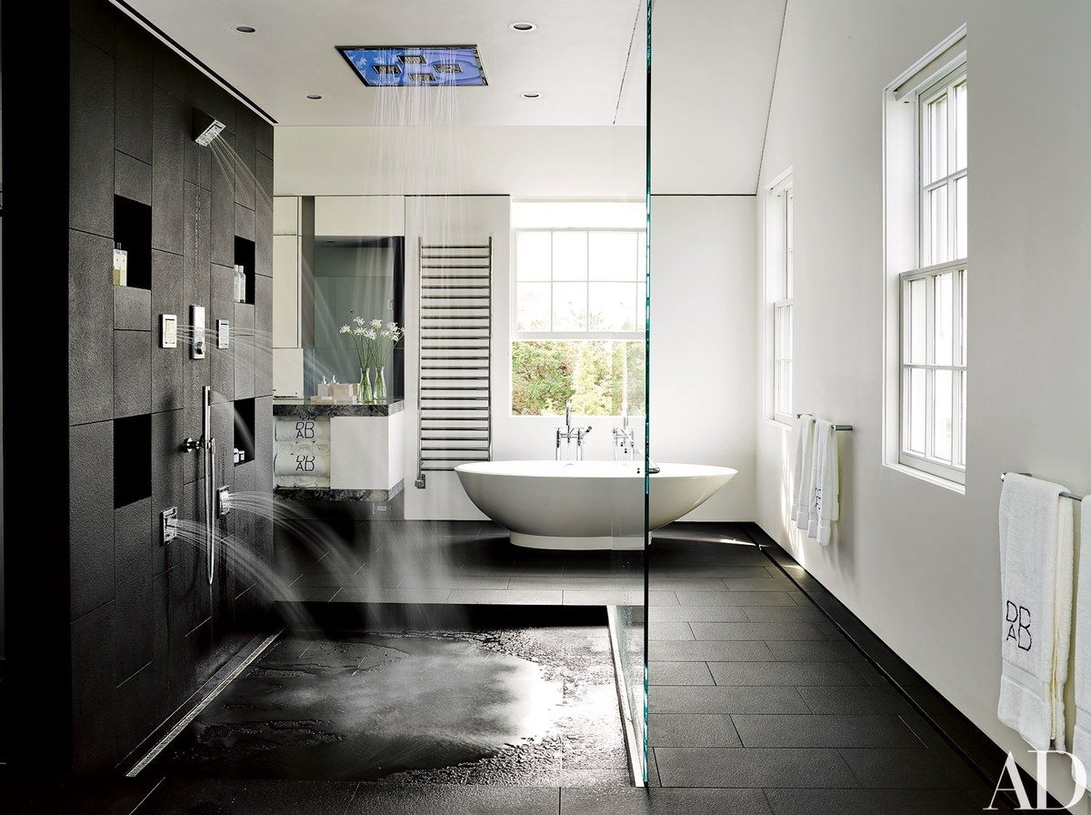 The master bath features a rain-shower system and body-spray ...