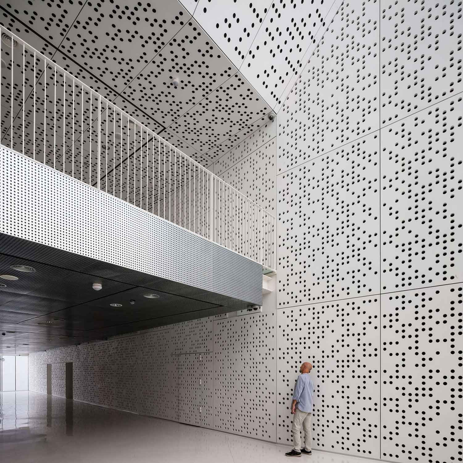 Stories On Design Perfectly Perforated Yellowtrace Facade Design Architecture Concrete Interiors