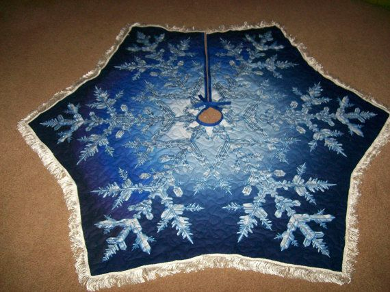 Snowflake Quilted Tree Skirt in shades of light to dark blue with