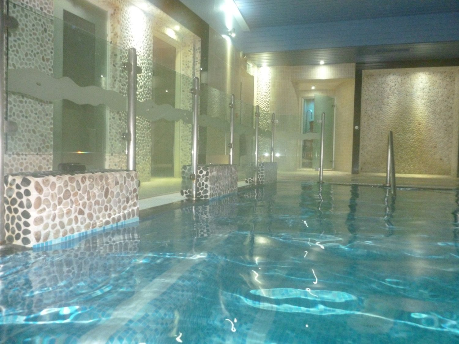 Relaxing hot water of the hydrotherapy pool with powerful massaging jets  and bubbling cascades of warm