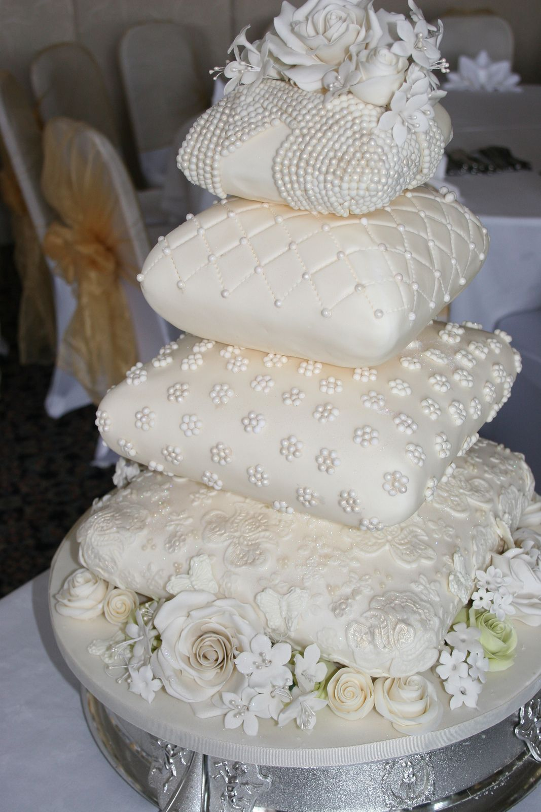 Four tiered cushionpillow wedding cake for the savoy pillow