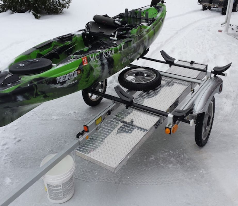 Craig hefner wanted to keep his rods safe on his trailer for Fishing kayak trailer